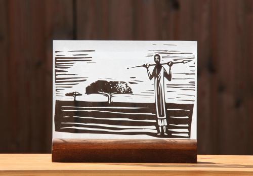 Gravure sur verre d'un homme dans la savane