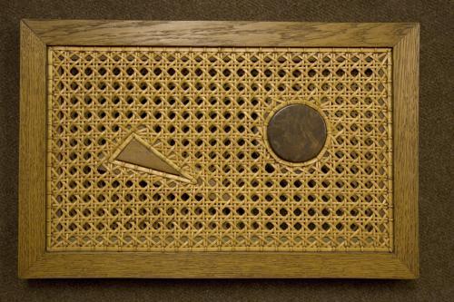 Inclusions dans un double cannage à la cheville de pièces de bois décoratives. Créations d'inclusions sur commande.