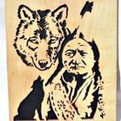 tableau de 20cm x 28,5 représentant Sitting bull et son loup en bois de poirier chantourné a la main dans mon atelier.