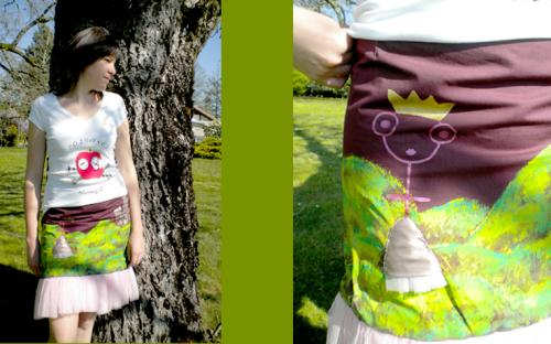 Jupe Princesse. Jupe trap�ze avec peinture princesse sur le devant. Couronne en volume au dos. Volant tullt en bas.
