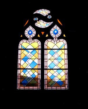 Vitrail d'une chapelle privée, inscrite à l'inventaire supplémentaire des monuments historique, à Cluny