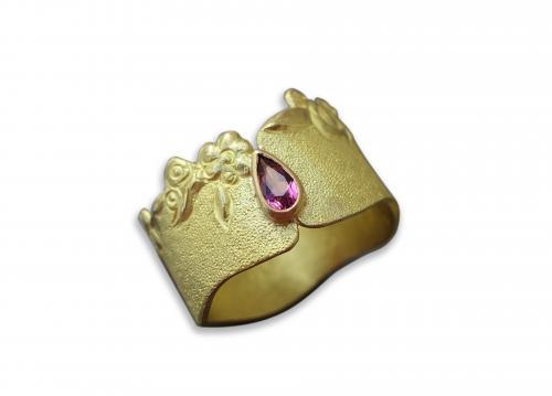 description: bague en or 18 carats ,pierre : tourmaline.