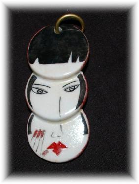 Pendentif porcelaine  Vendu avec jonc Dimensions : 7 * 3 cm  Création - Modèle unique