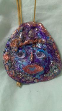 Un visage aux tons bleu et mordoré Référence B7