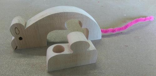 Souris puzzle avec un petit compartiment pour déposer la quenotte!!