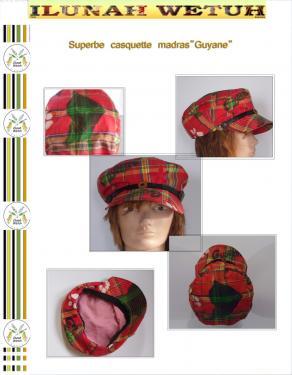 YANA  une casquette en tissus madras représentant la carte de la Guyane française. ce coin en Amazonie ou il fait bon vivre. une fine bande de cuir ornementé d'un bouton souligne la frontière de la visière avec le haut de la casquette. Jolie doublure en tissus. taille :