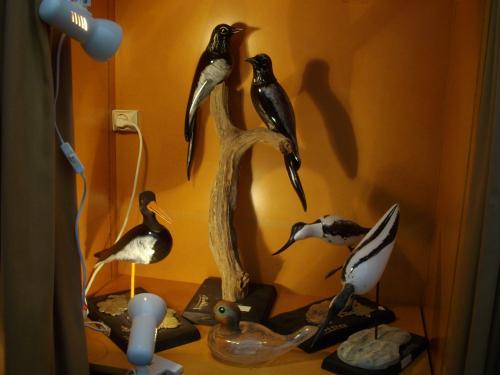 sculpture bois et verre réalisés avec un sculpteur sur bois