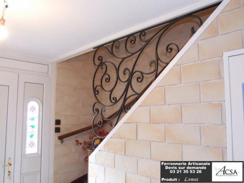 Elément décoratif pour montée d'escalier, réalisé en fer forgé traditionnel
