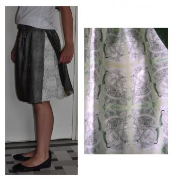 jupe taille 38. tissu de coton bio (popeline), recouvert d'un voilage vert fonc� ouvert sur le c�t�. motif : composition � partir d'un dessin de l'artiste. hauteur : 50 cm. mod�le unique.