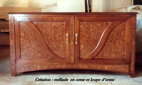 CREATION : enfilade en orme et loupe d'orme , deux portes , finition teintée et vernis .