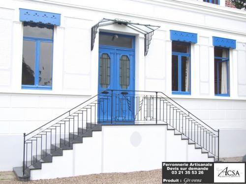 Marquise à trois pans conçue pour une maison flamande