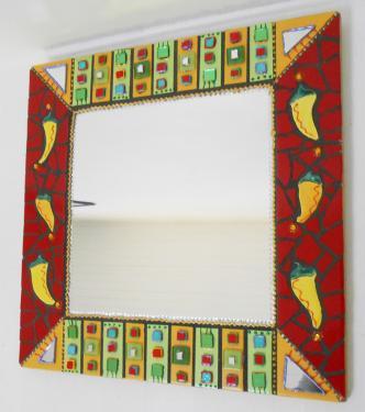 Miroir mosaïque 46 X 46 cm miroir en mosaïque sur structure bois : 46 X 46 cm -miroir: 29 X 29 cm Céramique en bandes: jaunet et anis- avec  en sur épaisseur des mosaïques rectangulaires -carrés de verre -carrés de miroir vert-cernées de peinture relief métallisée:violet/rouge/orange/doré/turquoise-mosaïque rouge avec de piments en céramique de ma fabrication-pièce unique à se faire offrir ou offrir pour savourer ses couleurs.