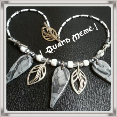 Collier gris-blanc en polymère et métal, verre et synthétiques
