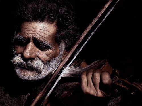 Joueur de violon carreaux 30x40cm 60.00 Euros sur mesure.