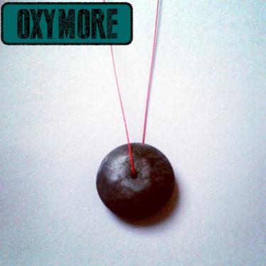 Le GonG : Pendentif en Cuivre Oxyd� de la Collection