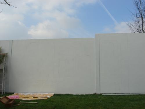 Mur préparé, enduit et peint avant la réalisation du trompe l??il.